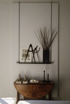 still life by mcalpine booth & ferrier/ love this as a hanging shelf, hang rope by hooks and display with old reclaimed wood shelf.