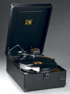 HMV portable gramophone, model 102, Serial No. B/10 124543, in a black leatherette case with metal corner plates, made by The Gramphone Co. Ltd, Hayes, Middlesex, England