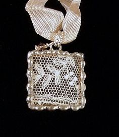 Antique lace behind glass, soldered necklace pendant by Dishfunctional Designs.
