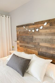 pallet headboard and ikea mounted side tables. clean and simple.