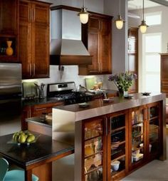Kraftmaid Kaffe cabinets. Idea for small kitchen to open up the space, but not lose cabinet space