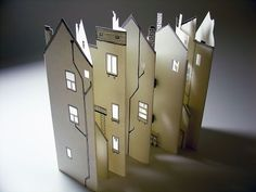 paper houses - medium and size ideas More Kyle Bean is studying Illustration at the University of Brighton, and has already been involved in projects for clients including Ford, The New York Times and BBC. His work has also been feature… Concertina Book, Accordion Book, Arte Pop Up, Paper Houses, Paper Folding, Book Folding, Handmade Books, Miniature Houses, Book Making