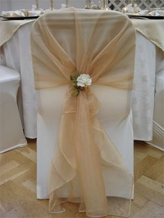 ivory chair cover with gold organza sash and ivory rose tieback decoration from pumpkin events - Rose Gold Wedding Chairs Covers Wedding Chair Decorations, Wedding Chairs, Wedding Centerpieces, Wedding Table, Wedding Chair Sashes, Wedding Ideas, Chair Bows, Burlap Chair Sashes, Table Covers