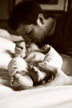 Awe, a dad and his baby.. always cute pics.