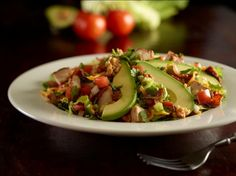 Hard Rock Cafe Smokehouse Chopped Salad - Freshly chop mixed field greens tossed with diced smoked chicken, spicy bacon  pecans, cheddar cheese, pico de gallo with a smoky citrus vinaigrette and topped with fresh sliced avocado.