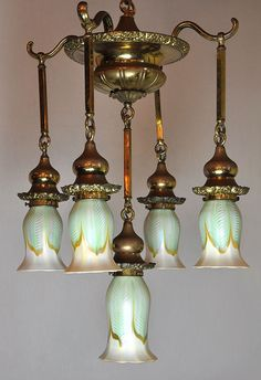 This is just plain gorgeous! ~ Original Quezal Fixture ~ The Quezal Art Glass and Decorating Company was founded on March 1902 by Martin Bach who studied under Tiffany for almost a decade. Victorian Lamps, Antique Lamps, Vintage Lamps, Vintage Industrial Lighting, Antique Lighting, Art Nouveau, Lampe Art Deco, Vintage Light Fixtures, Chandelier Lighting