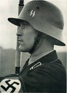 SS helmet - probably original photo , looks like war I era helmet with ss insygnia before they were standardized , hand painted? German Soldiers Ww2, German Army, Military Photos, Military History, Luftwaffe, German Helmet, Germany Ww2, Man Of War, German Uniforms