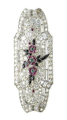http://rubies.work/0654-ruby-rings/ An art deco ruby, onyx and diamond brooch. The tapered rectangular-shaped plaque set throughout with single and circular-cut diamonds, to the central floral motif set with ruby and emerald flowerheads and onyx leaves, mounted in platinum, circa 1925