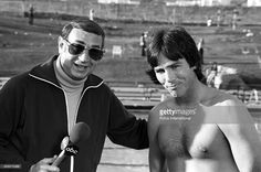 Sports announcer Howard Cosell interviews ABC actor Richard Hatch during the Battle of Network Stars in November, 1976 in Los Angeles, California.