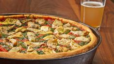 Deep dish Mediterranean pizza (red bell pepper, green olives, artichoke hearts, feta and jack cheese.)