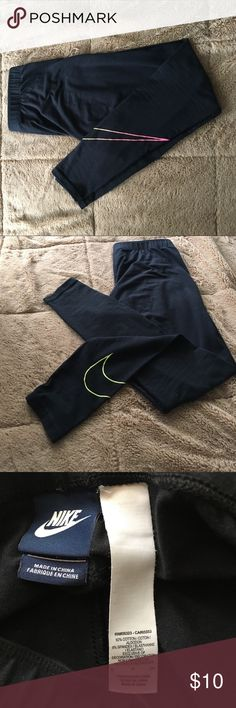 Nike Ankle fit workout leggings Nike Ankle fit workout leggings with Nike symbol detail on bottom of leg. These are in great condition! Nike Pants Track Pants & Joggers