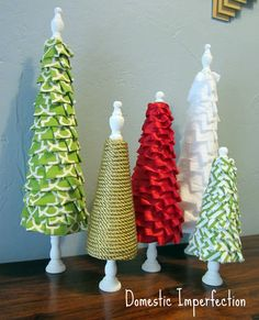 Mini Christmas trees made from scrap fabric, ribbon and rope.empty thread spools would work for a base too Ribbon On Christmas Tree, Christmas Tree Crafts, Christmas Countdown, Christmas Projects, All Things Christmas, Winter Christmas, Holiday Crafts, Christmas Holidays, Christmas Decorations