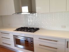 The kitchen is now complete with its Mudgee Pressed Metal Splashback