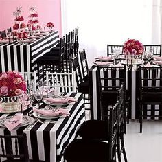 Black and White Striped tablecloth with pink centerpieces and napkins.  Source unknown, please post a comment if you know the original source!