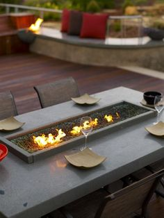 Small fire pit on outdoor dining table.