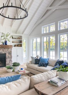 navy and french blue pillows. White planked lake house living room with blue and white decor. Stone fireplace with rustic beam mantel. Hamptons Living Room, Coastal Living Rooms, Home Living Room, Living Room Decor, Living Room Blue, Dining Room, French Country Living Room, French Cottage, Les Hamptons