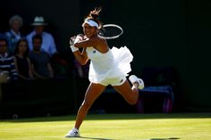 Heather Watson Photos Photos - Heather Watson of Great Britain plays a backhand during the Ladies Singles first round match against Maryna Zanevska of Belgium on day one of the Wimbledon Lawn Tennis Championships at the All England Lawn Tennis and Croquet Club on July 3, 2017 in London, England. - Day One: The Championships - Wimbledon 2017