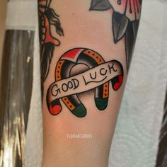 neo-traditional horseshoe tattoo good luck