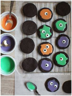 Soft, dark chocolatey sugar cookies with melted monsters made of royal icing & candy eyes!