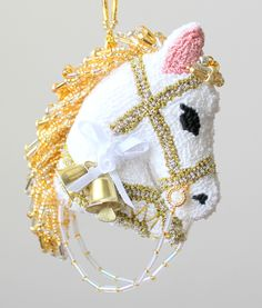 The Two Bells Horse with white bow Christmas Ornament is available on Etsy at Safe Harbor Boutique.