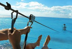Zip-lining over the ocean in Isla Mujeres Mexico