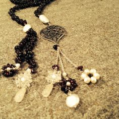 Garnet gemstone long necklace with a silver Arabesque motif, and freshwater white pearls drops, and a tassel with small flowers of garnets, pearls and rock crystals dangling off a silver chain.