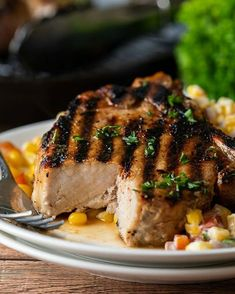 Tender and juicy grilled pork chops are a super quick and easy recipe for bbq's and cookouts! Side Dishes Easy, Side Dish Recipes, Dinner Recipes, Dinner Ideas, Main Dishes, Seared Pork Chops, Grilled Pork Chops, Cooking Pork Chops, Corn Salad Recipes