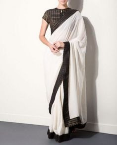White georgette saree with black border and black high neck blouse