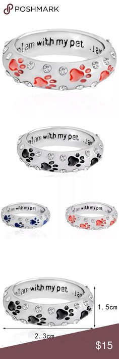 "🆕 (E24) Red Paw Print Ring Rings are white gold plated with crystal gems. On the inside of the ring it says ""when I'm with my pet I'm complete""  Sizes are 6, 7, and 8. I have all red, blue and black. Each have their own listing. Jewelry Rings"