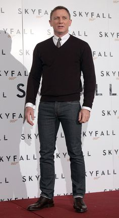 Daniel Craig wore a sweater and jeans to the photocall. | Daniel Craig Debuts Skyfall in Italy With a Bond Girl by His Side | POPSUGAR Celebrity Photo 9