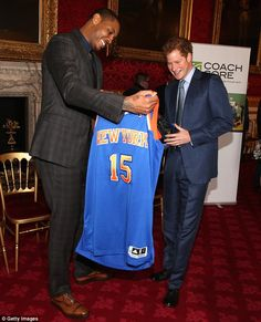 At the reception in aid of the Royal Foundation's Coach Core programme, Harry was presented with his own personalised basketball shirt