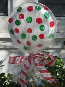 Christmas lollipops - Super cute as a garden Christmas decoration. Line your driveway with them!  COST: $1.00 INCLUDES: everything you see.