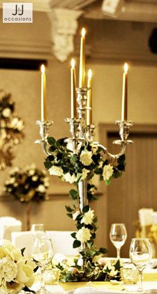 Simple flowers with out detracting from the candelabra