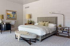 Really like the two different side tables here for the bed - the open one is great. And I like that longer lamp.