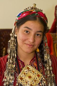 Turkmenistan | Girl in traditional clothes and jewellery | ©Robert Harding