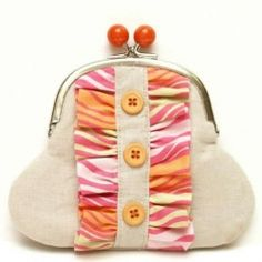 Sweet linen coin purse decorated with little buttons and ruffles.