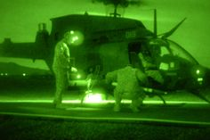 Two 2nd Squadron, 6th Cavalry Regiment, 25th Combat Aviation Brigade, Soldiers work together to re-arm an OH-58 Kiowa Warrior with rockets during night aerial gunnery and FARP operations at the Pohakuloa Training Area, Feb. 5. #ArmyAviation