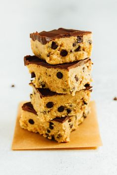 These no bake cookie dough bars have a base of grain-free chocolate chip cookie dough topped with layer of melted vegan chocolate.