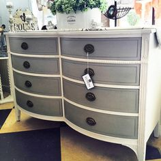 Paint it Beautiful! Vintage bow front dresser painted in Champlain with Linen on the drawers. Metallic paint was also used to brighten up the drawer pulls. Love this!