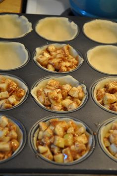 APPLE MINI PIES  Cut 8 apples into bits,Mix the apples with: 12 tablespoons of flour,  1 1/2c of sugar,  4 heaping teaspoons of cinnamon,  1/4-1/2 teaspoon of nutmeg.   You will also need:   4 tablespoons of chilled butter cut into 24 equal portions.    two boxes of pilsbury pie crusts (four chilled NOT frozen crusts) cut w/mason jar lid, makes 24 pies w top strips of crust. 400 degrees, 18-22 mins.