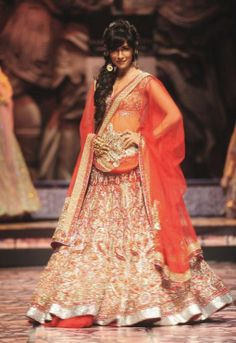 India Bridal Fashion Week 2013 – Suneet Varma - showstopper Chitraganda Singh in red bridal lehenga