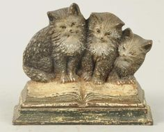 Cast Iron Kittens on Books Doorstop.  My sisters and me.  I'm the little one on the right trying to stay on.