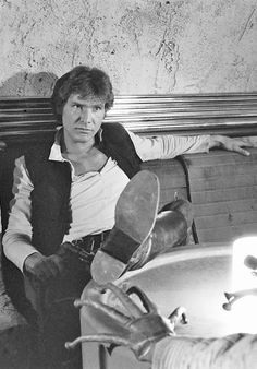 Harrison ford as the rouge we all love, Han Solo in starwars.