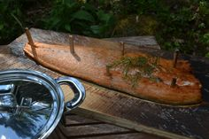 """The Finnish way of preparing """"blazing salmon"""": 1)  Salmon is first nailed to a plank with wooden pegs 2) It is then """"blazed"""" in upright position nearby the open fire.  3) During the """"blazing"""" it is drizzled with salted water with some juniper in it.   This kind of food is often prepared during the hiking or kayaking trips in the wilderness. Just imagine, how good it tastes in the middle of the nature!   #salmon#recipe#finland"""