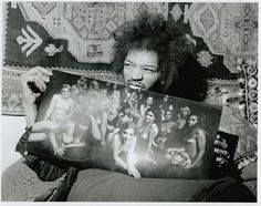 Hendrix holding the original Electric Ladyland  album cover