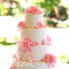 Sugar flowers and delicate sugar petals decorated the four-tiered cake.