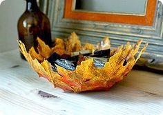 Leaf bowl round.  Coat an upside down bowl with cooking spray, then plastic wrap.  Cover with soft colorful leaves, then paint heavily with mod podge and dry overnight.