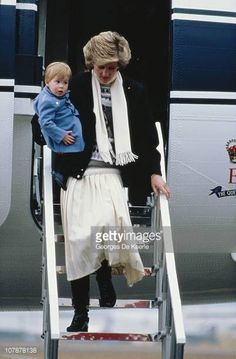 March 14, 1986: Princess Diana with Prince Harry as they arrive at Aberdeen Airport In Scotland.