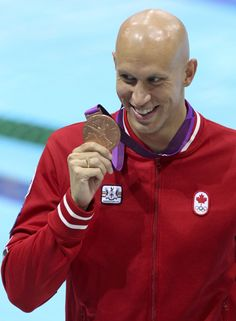 Brent Hayden of Vancouver shows off his bronze medal in men's 100-metre freestyle in swimming competition at the 2012 London Olympic Games, Wednesday, Aug. 1, 2012.   COC Photo: Mike Ridewood