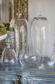What do you get when you turn clear glass vases upside down, and add a glass knob? A cloche, of course!
